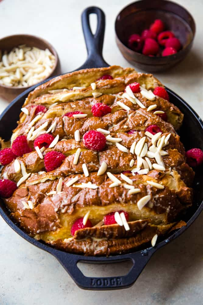 raspberry almond french toast in a cast iron pan