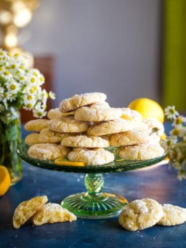 green cake stand with lemon bars cookies