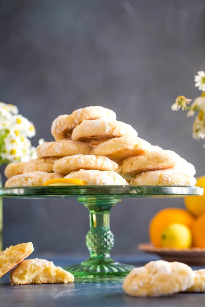 green cake plate with lemon crinkle cookies