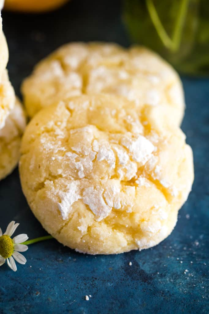 two lemon bar cookies on blue background