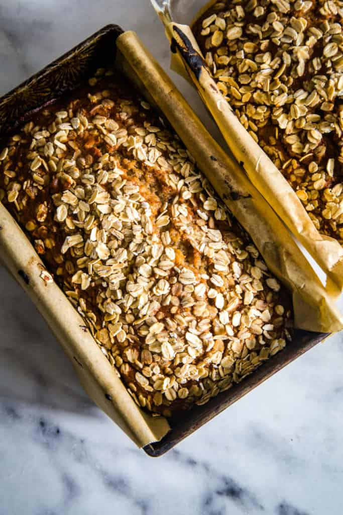 applesauce oatmeal bread in pans on marble background