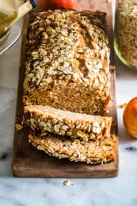 applesauce oatmeal bread on wood cutting board
