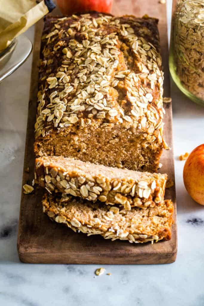 applesauce oatmeal bread on wood cutting board