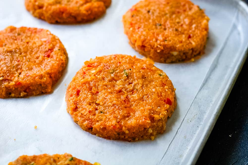 raw salmon patties on a cookie sheet