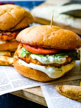 chipotle salmon burgers on newspaper