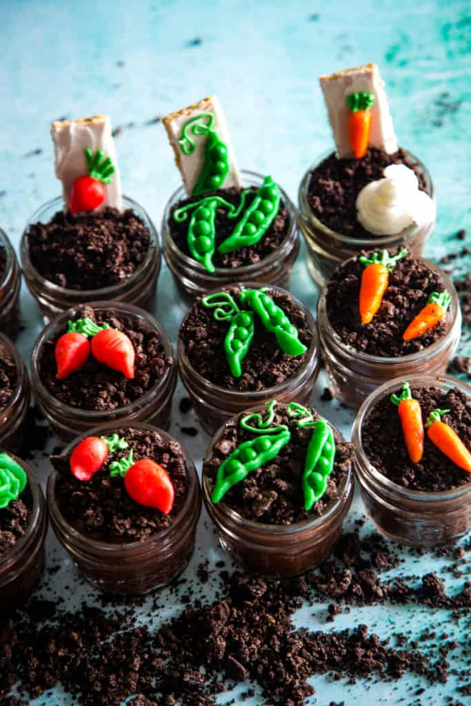 pudding cups in jars with pea shaped marzipan vegetables