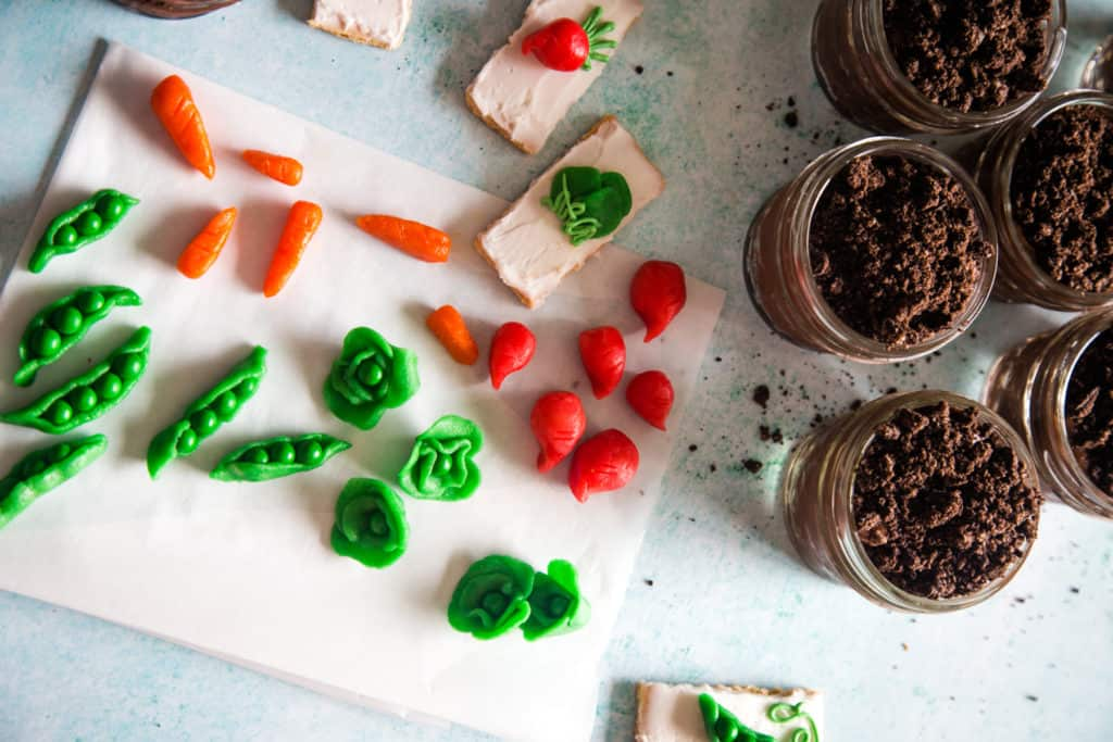 marzipan vegetables on white parchment paper