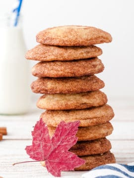stack of maple snickerdoodle cookies with red maple leaf