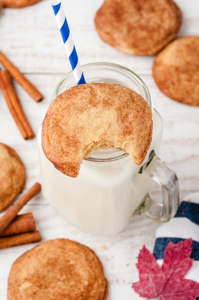 cup of milk with cookie on rim