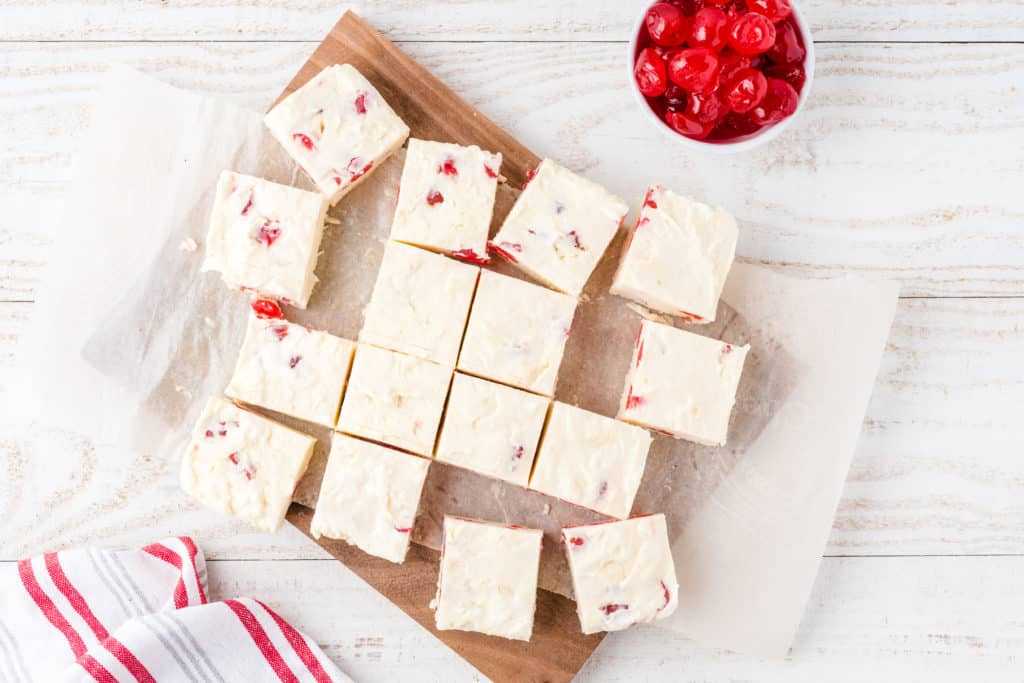cherry cheesecake fudge cut into squares on a cutting board