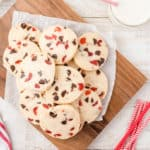 da plate of dark chocolate cherry cookies on wood cutting board