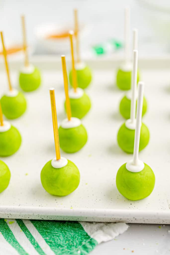 tray of uncoated green cake pops