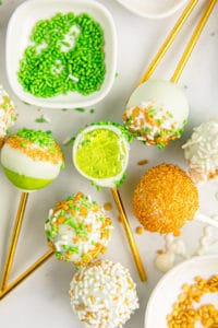 green cakes pops on a white background