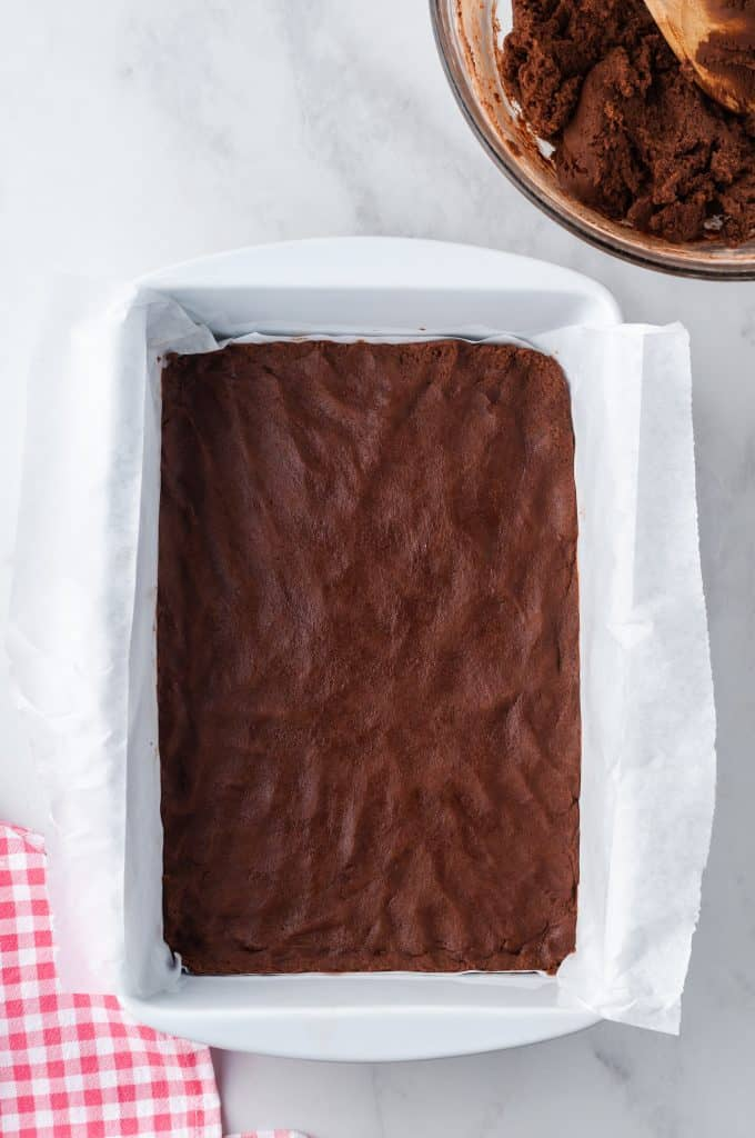 lined pan with brownie batter in pan