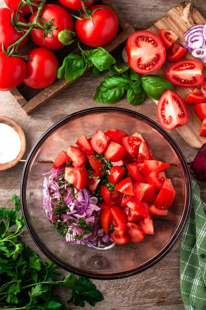 bowl of chopped tomatoes and red onions