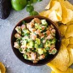 salmon ceviche in wood bowl with tortilla chips