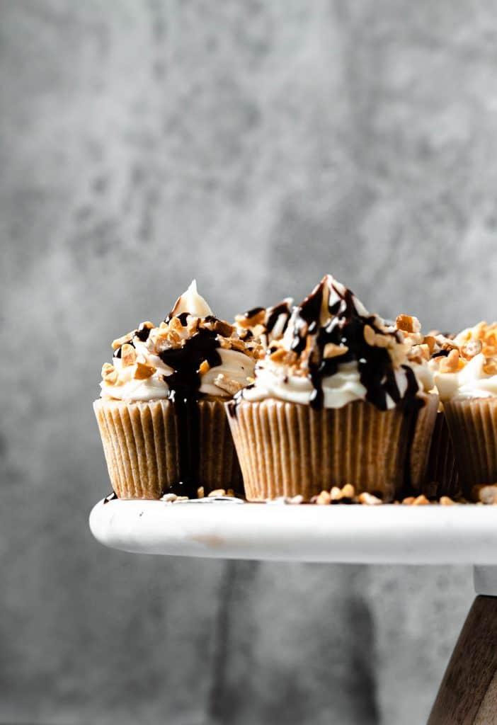 beer cupcakes on white cake stand and metal background
