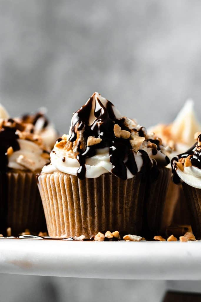 cupcakes on a cake plate with metal background