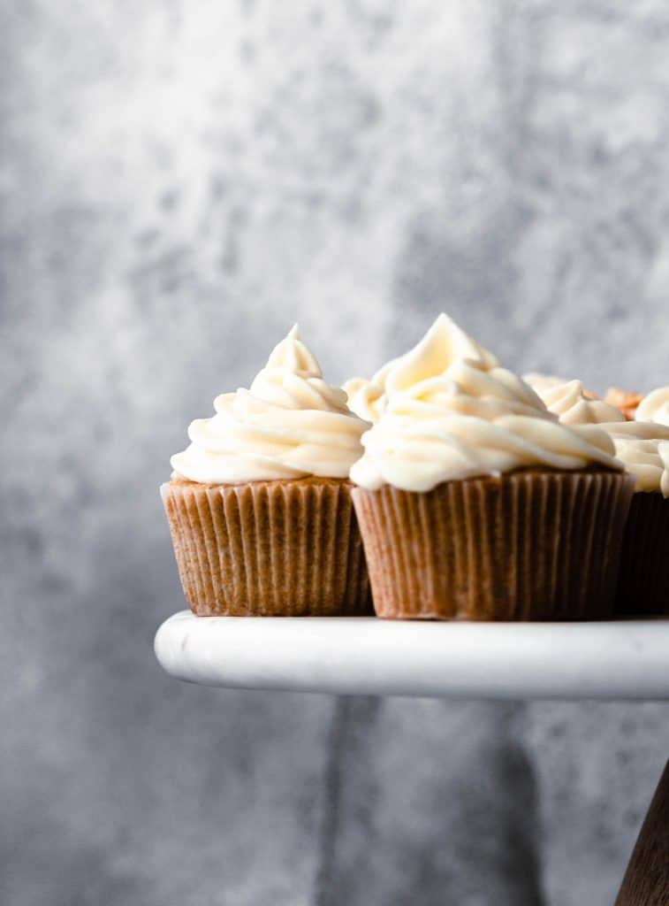 beer cupcakes on white cake plate