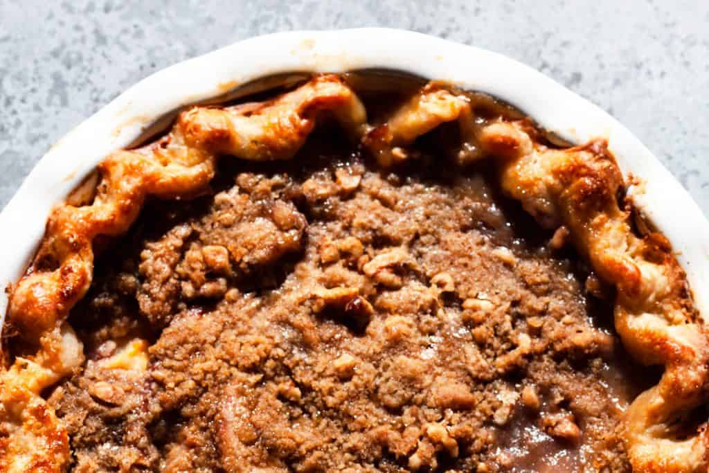 shot of whole baked peach pie crumble