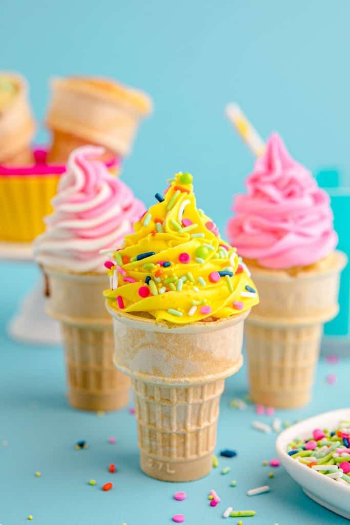 three ice cream cone cupcakes with sprinkles