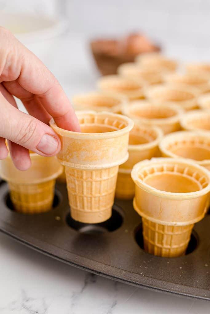 placing cones in mini muffin pan