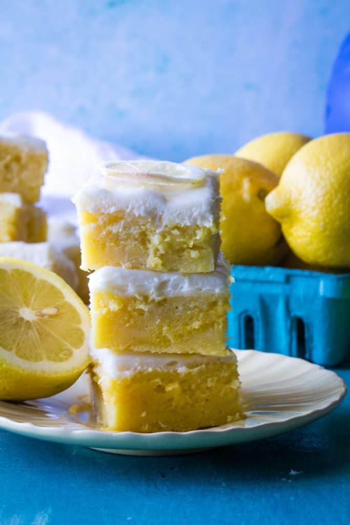 plate of 3 lemon brownies on b Lue background