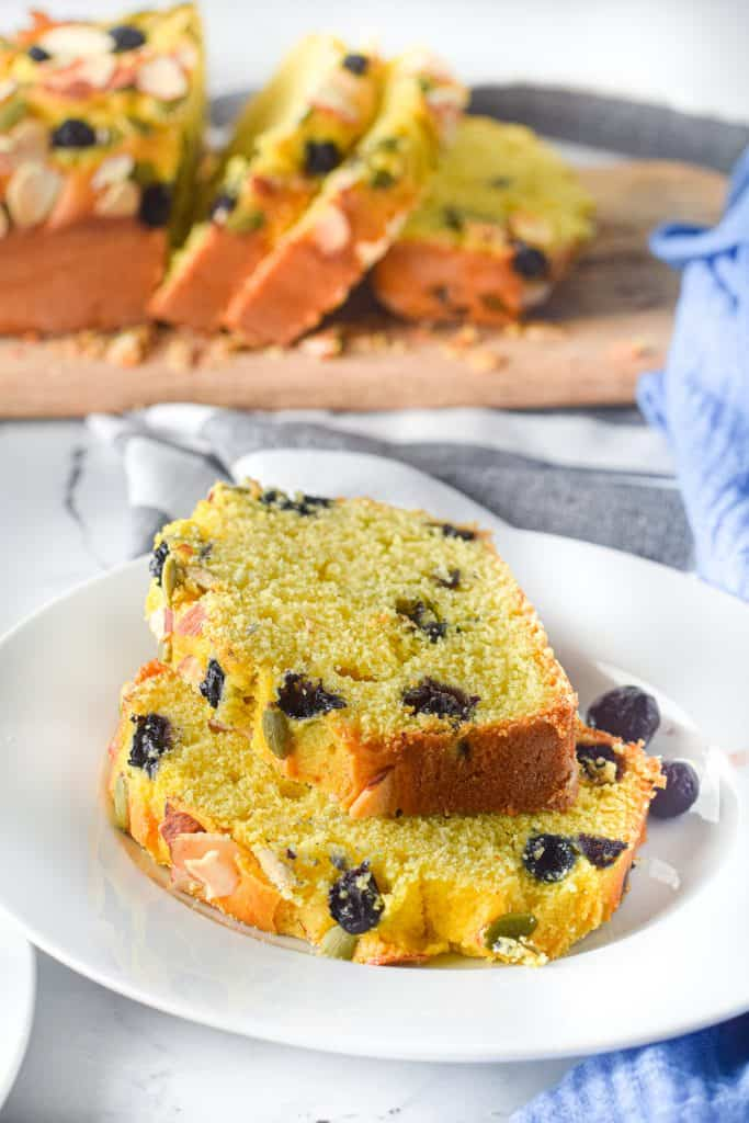 plate of two slices of pumpkin blueberry bread