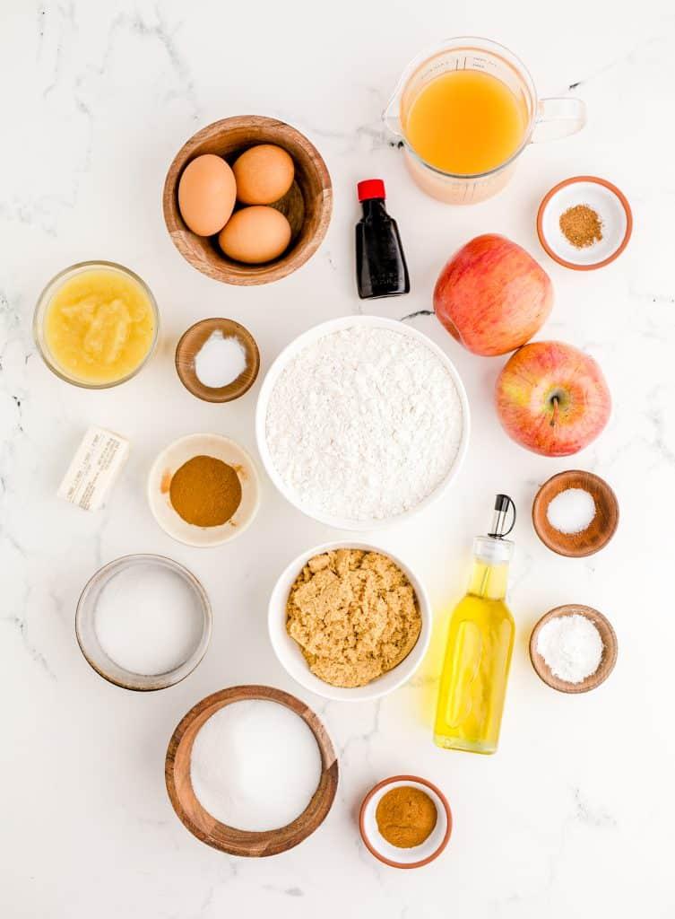 ingredients for apple cider donut cake on white background