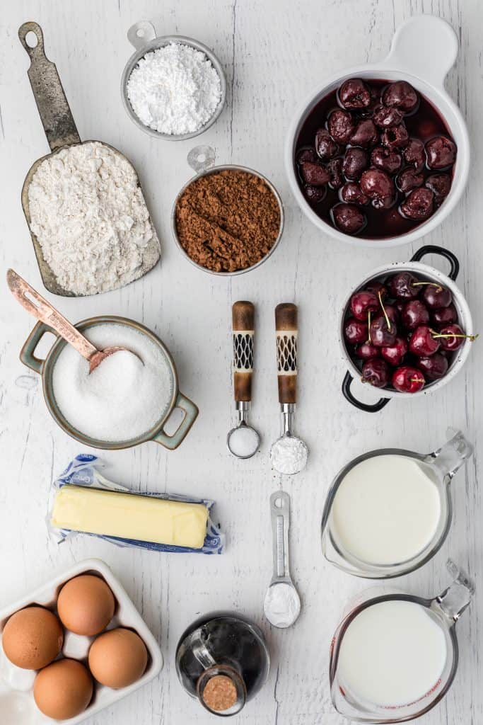ingredients for Black Forest cake on white background