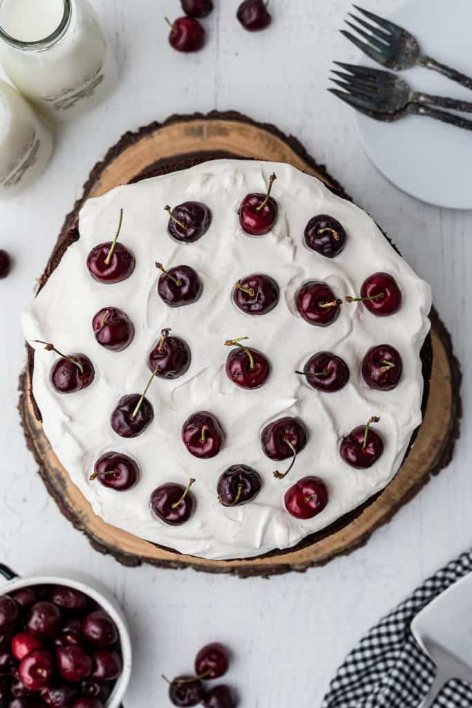 layering the cherries on the whipped cream