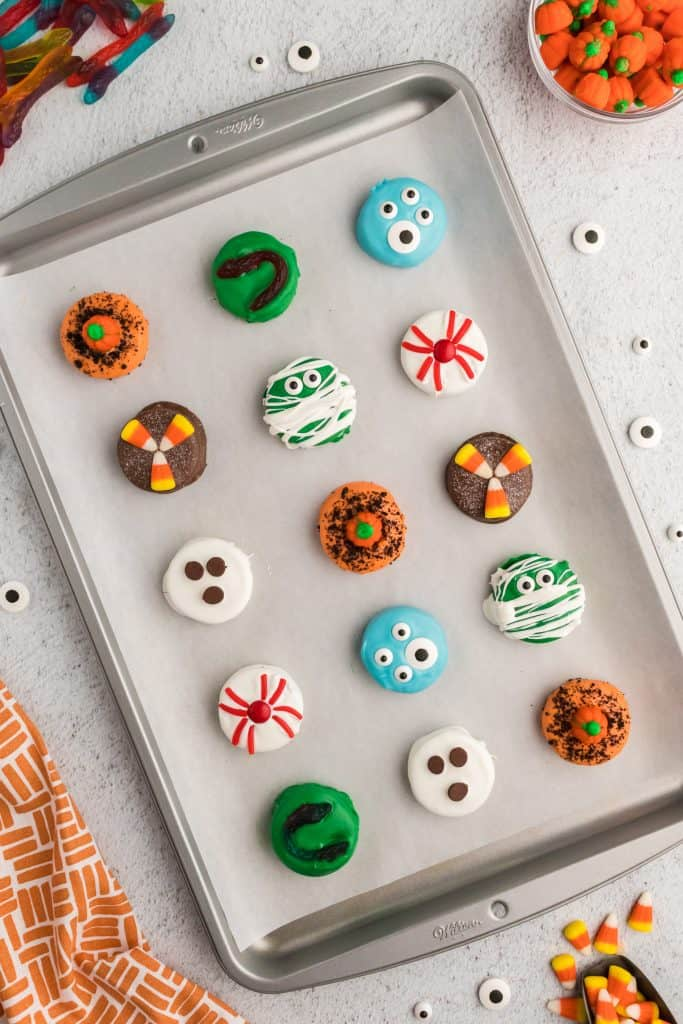 cookie sheet with halloween dipped Oreos