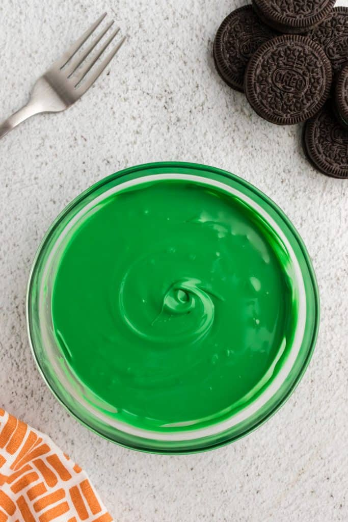 glass bowl of green melted chocolate