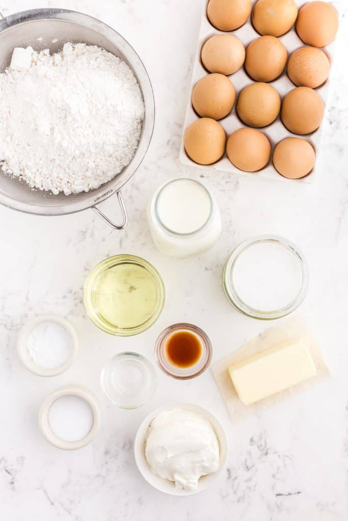 white cupcakes ingredients on white background