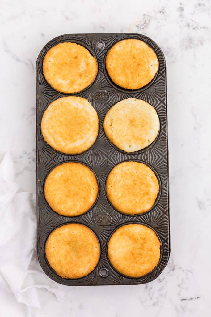 baked white cupcakes in pan