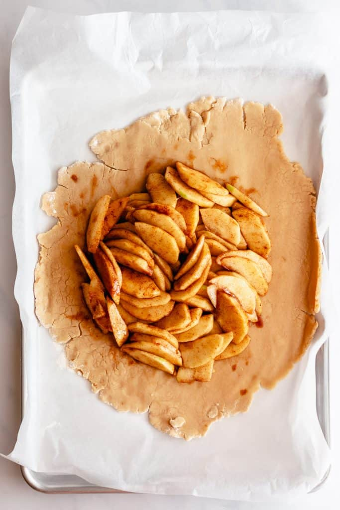adding apples with the galette dough