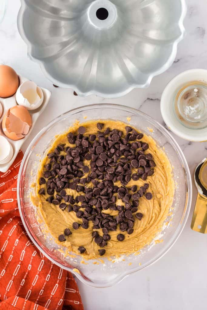 mixing in the chocolate chips into pumpkin Bundt Cake batter