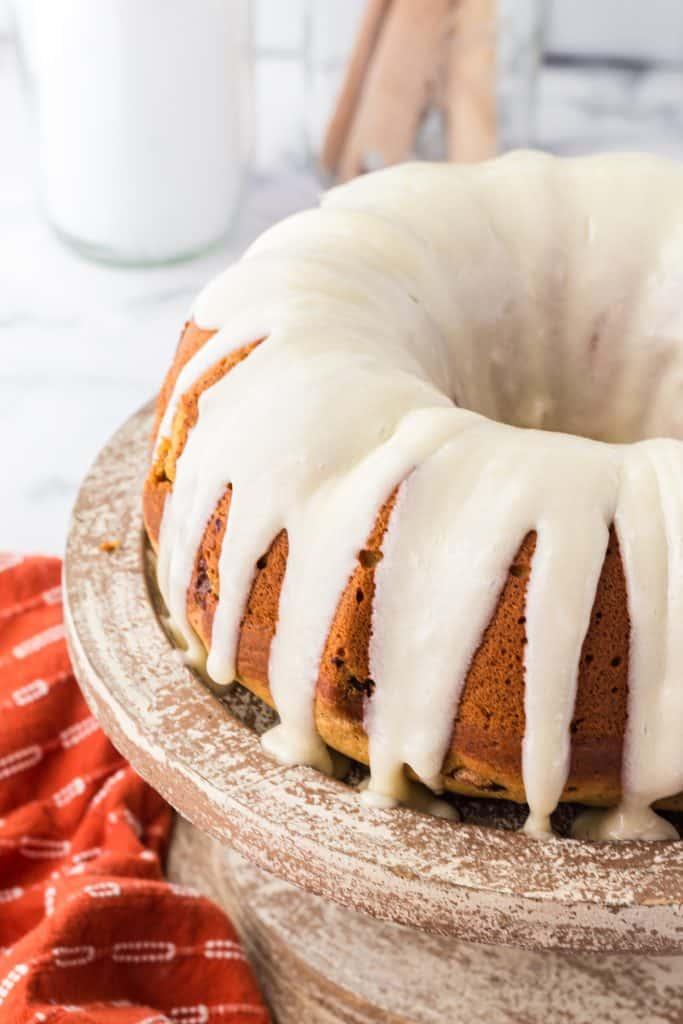 pumpkin chocolate chip Bundt Cake on wooden cake plate