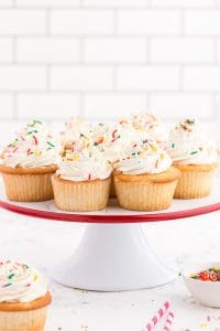 white cake plate with white cupcakes