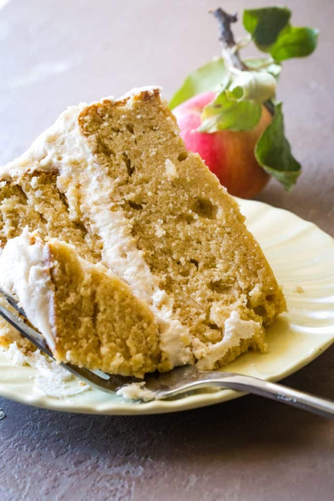 slice of apple cider cake on yellow plate