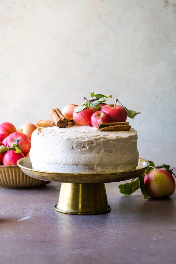 apple cider layer cake on gold cake stand