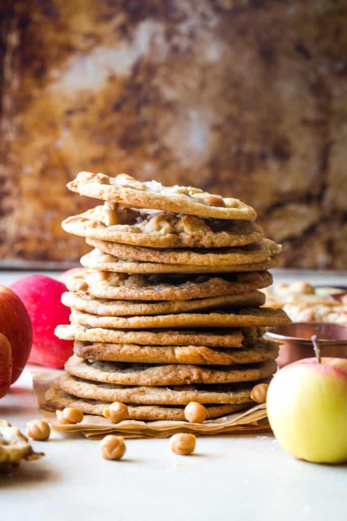 stack of caramel apple cookies with metal background