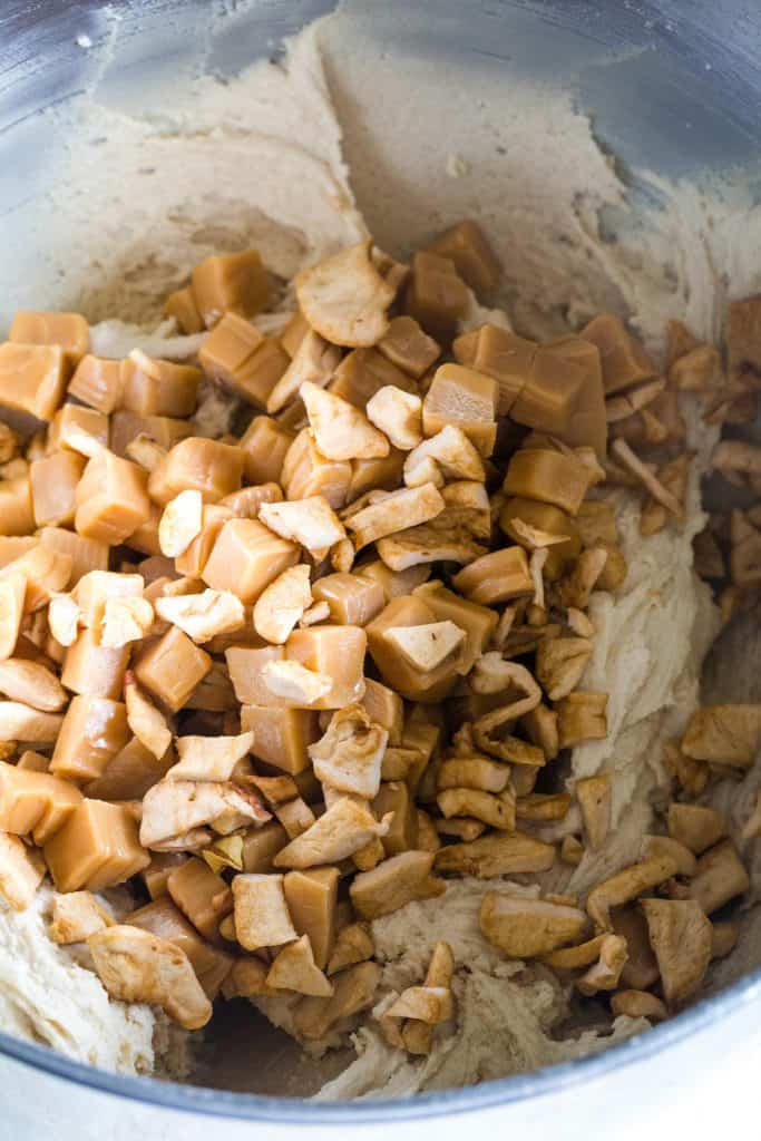 dried apples and caramel chunks in cookie batter