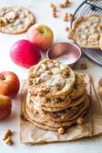 stack of caramel apple cookies on brown parchment paper