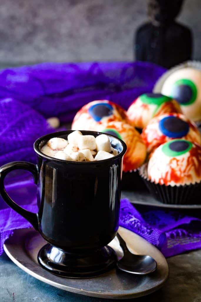 black mug with hot chocolate