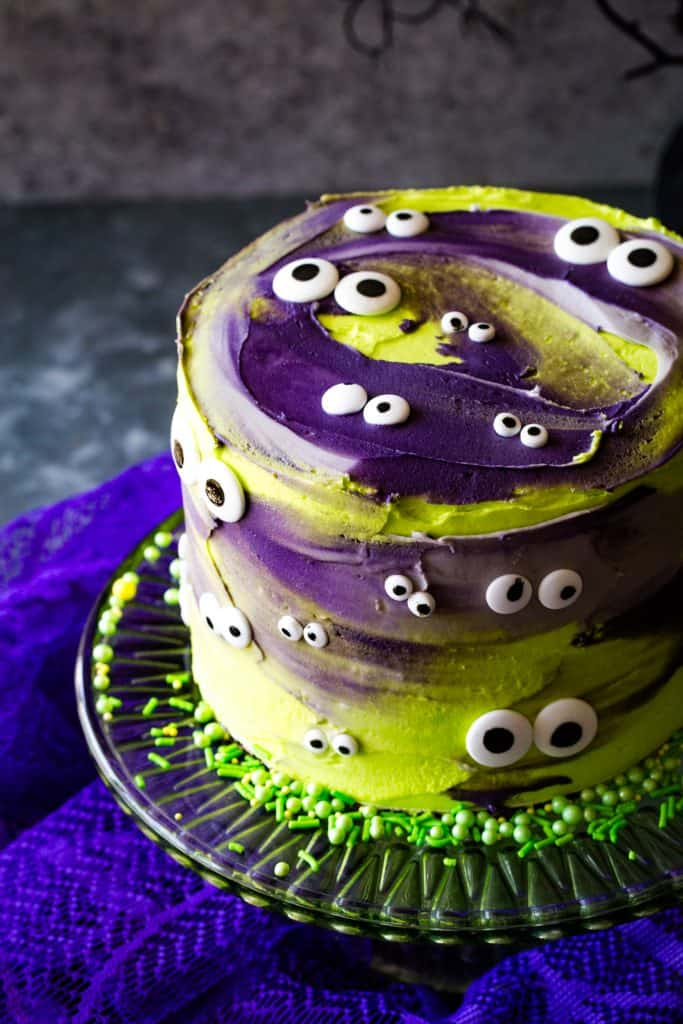 vertical shot of monster eye cake on green cake stand