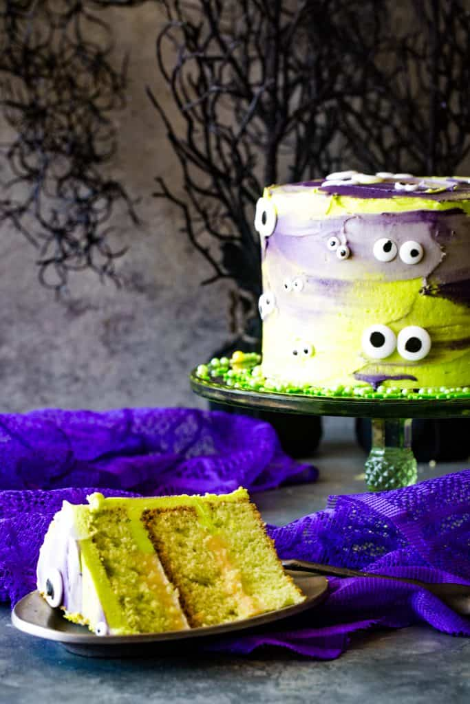 slice of monster cake on silver plate with whole cake in background
