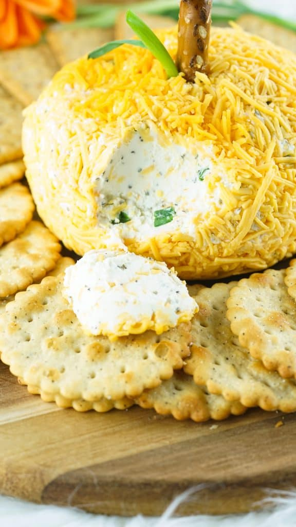 cracker with cheese from pumpkin shaped cheese ball