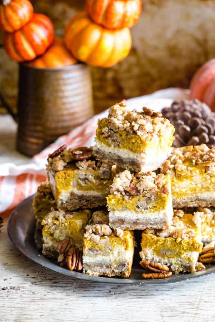 plate of pumpkin cream cheese bars
