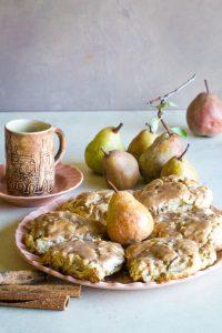 cinnamon glazed pear scones on peach plate